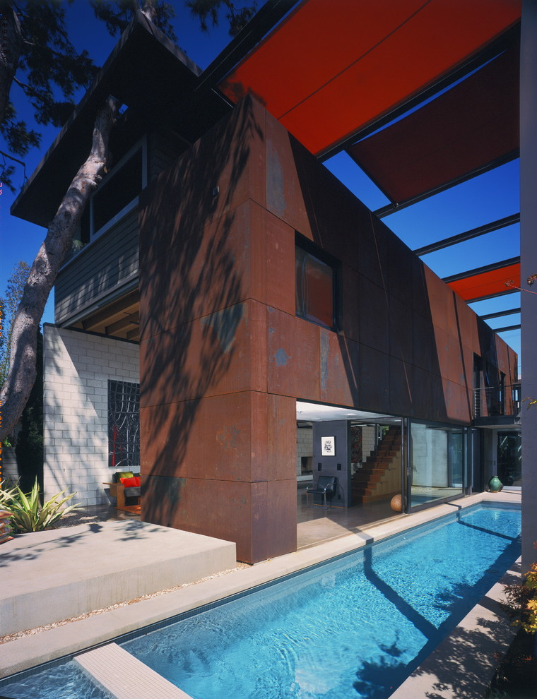 Example of a mid-sized urban two-story metal exterior home design in Los Angeles