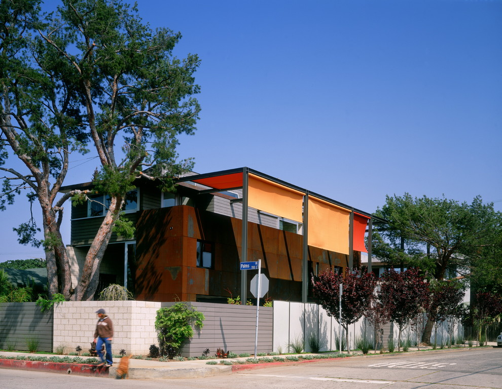 Urban orange two-story metal exterior home photo in Los Angeles
