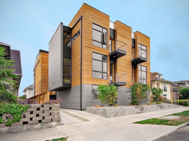 Example Of A Minimalist Wood Apartment Exterior Design In Seattle