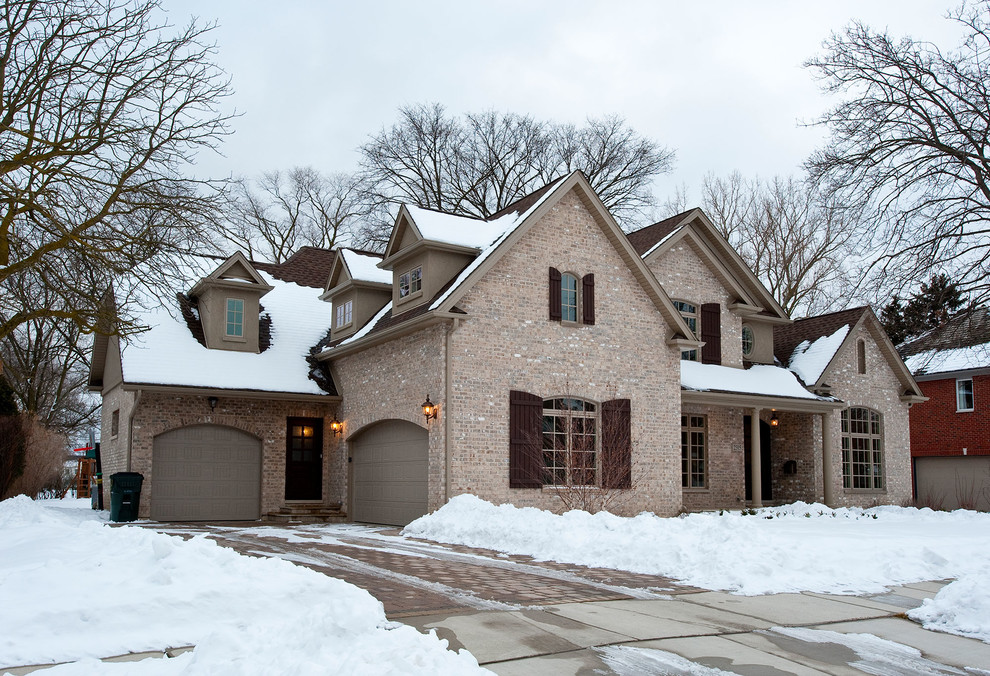 Inspiration for a timeless multicolored two-story brick exterior home remodel in Chicago with a shingle roof