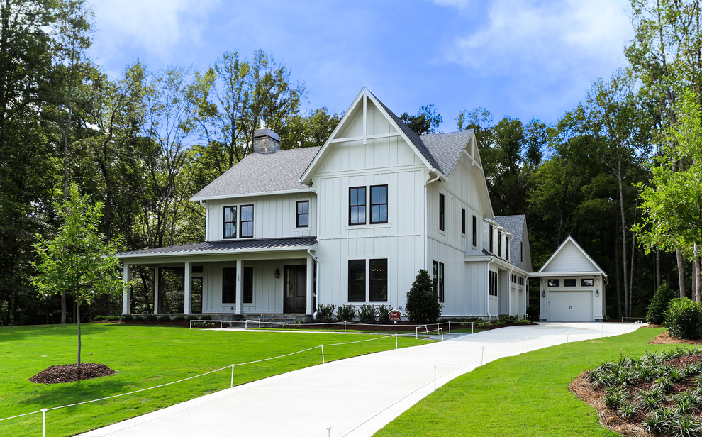 Large cottage white two-story wood gable roof idea in Raleigh
