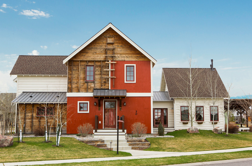 Cottage red two-story mixed siding gable roof photo in Other