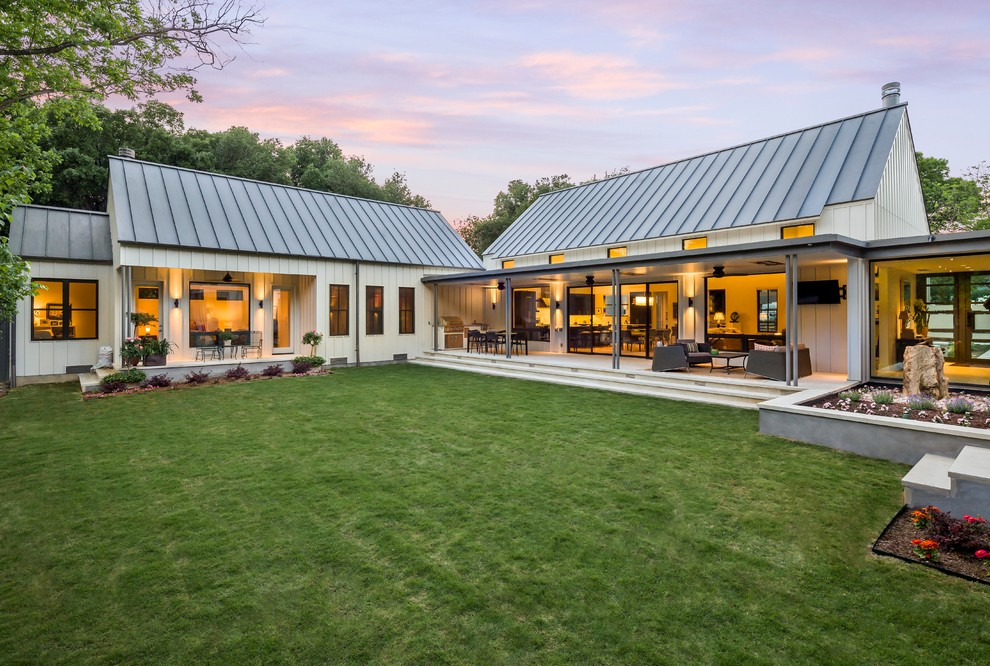 Example of a farmhouse white one-story wood exterior home design in Dallas