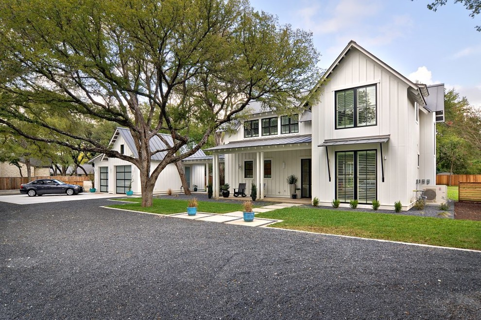 Inspiration for a cottage two-story exterior home remodel in Austin