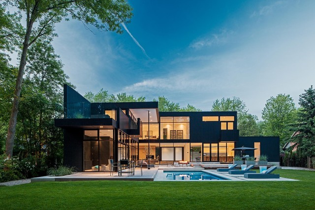 large minimalist black two story exterior home photo in toronto