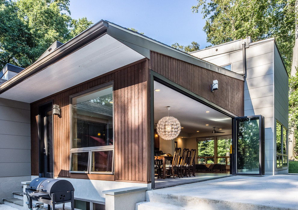 Inspiration for a large modern gray two-story exterior home remodel in Philadelphia with a shed roof