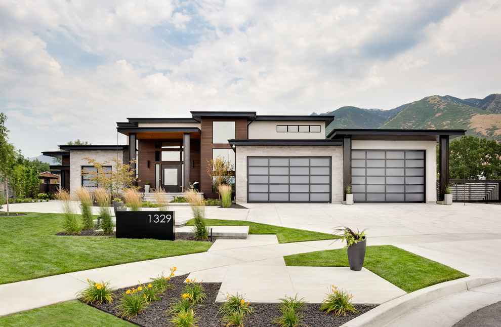 Example of a trendy one-story mixed siding exterior home design in Salt Lake City
