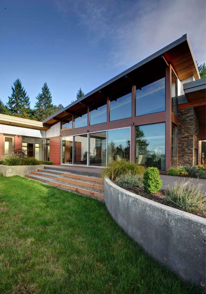 Trendy red one-story metal exterior home photo in Portland