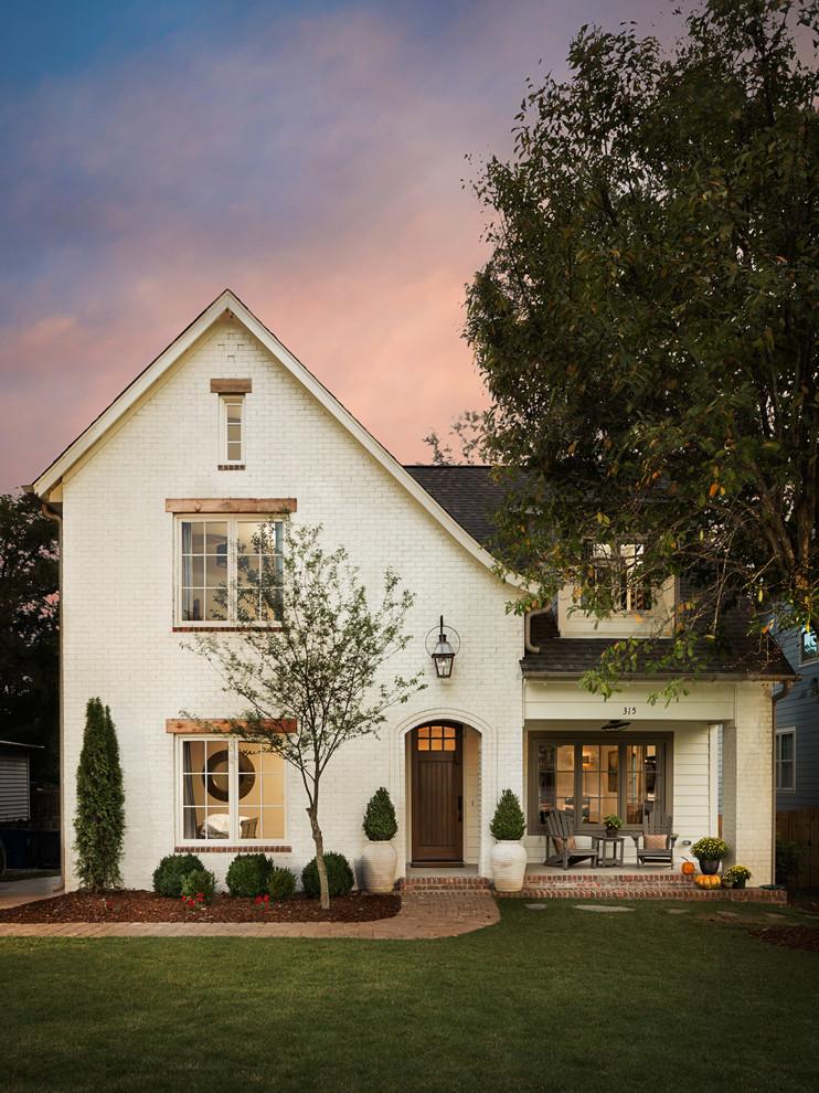 Mid-sized elegant white two-story brick exterior home photo in Birmingham