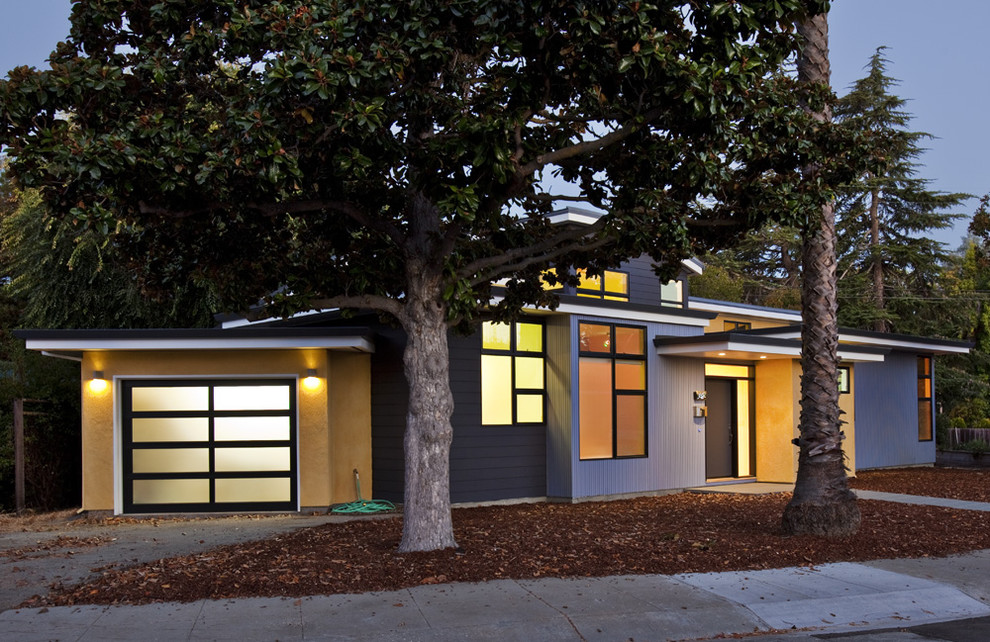 Inspiration for a contemporary multicolored two-story mixed siding exterior home remodel in San Francisco with a metal roof