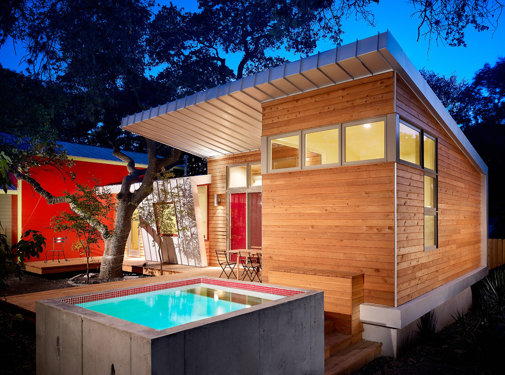 Modern wood exterior home idea in Austin with a shed roof