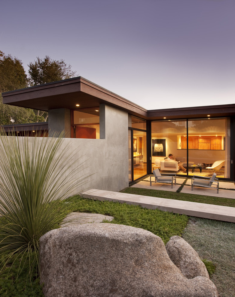 Example of a minimalist one-story glass exterior home design in Santa Barbara