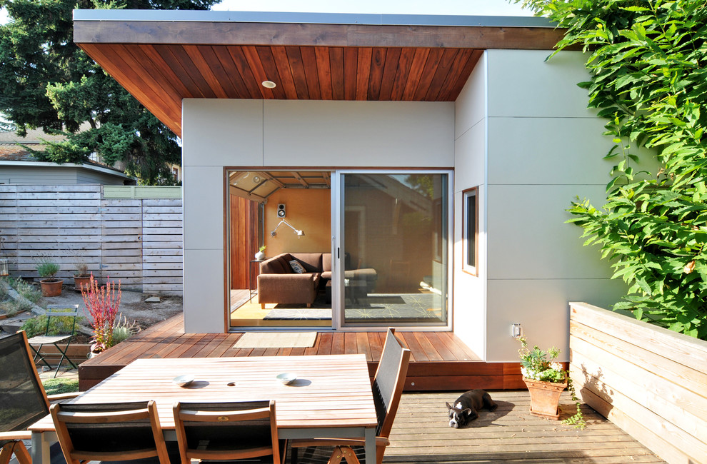 Example of a mid-sized minimalist white one-story house exterior design in Seattle