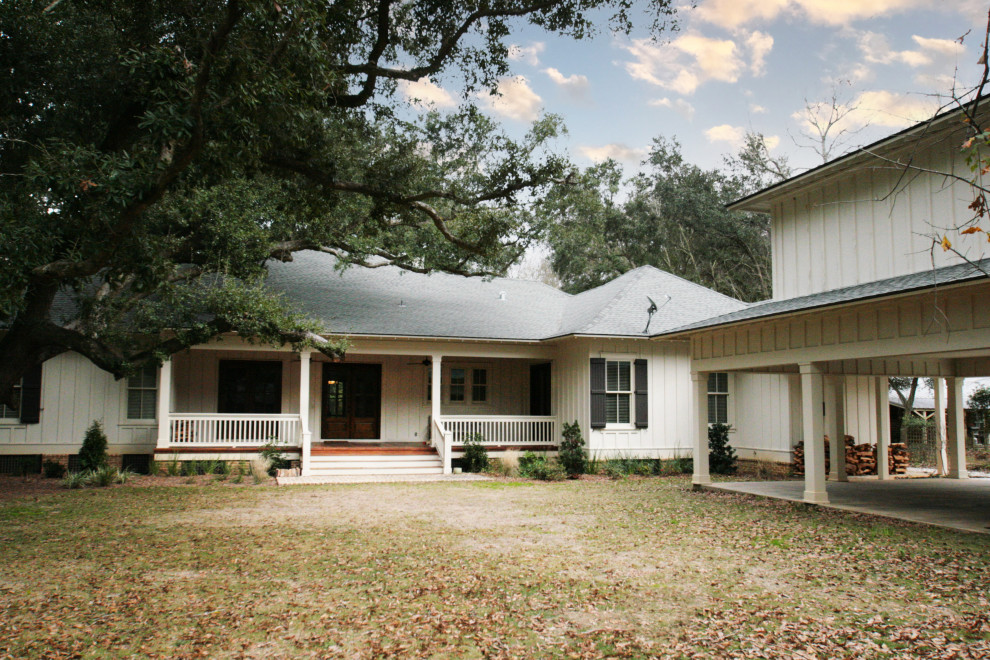 Craftsman white one-story exterior home idea in Other