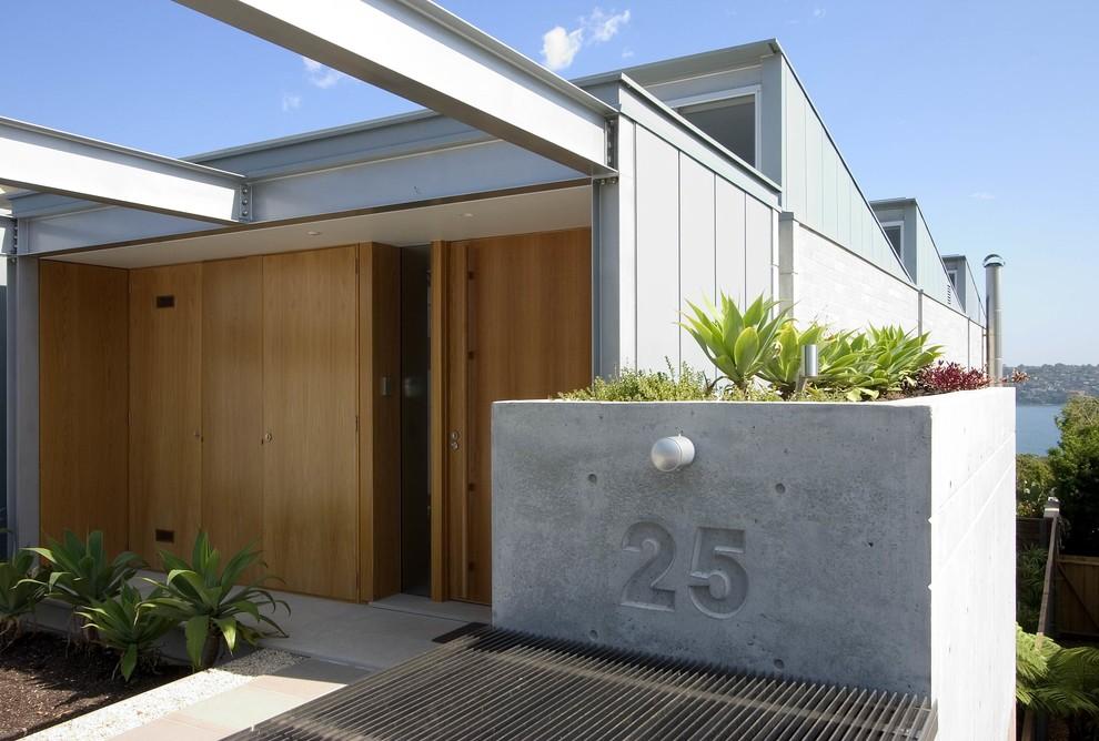 Minimalist wood exterior home photo in Sydney