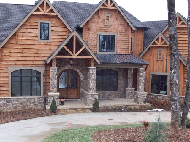 mountain home with rustic wood siding
