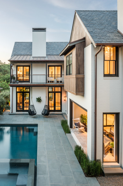 Inspiration For A Transitional White Two Story Brick Gable Roof Remodel In  Houston