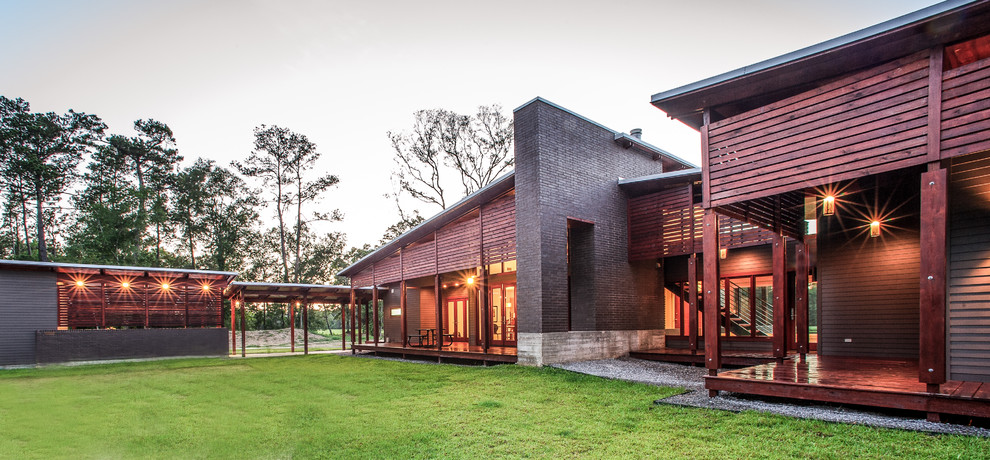 Contemporary wood exterior home idea in Other