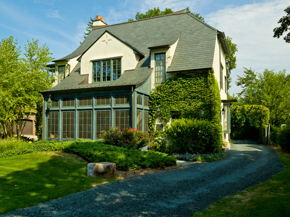 Example of a mid-sized classic two-story exterior home design in Chicago