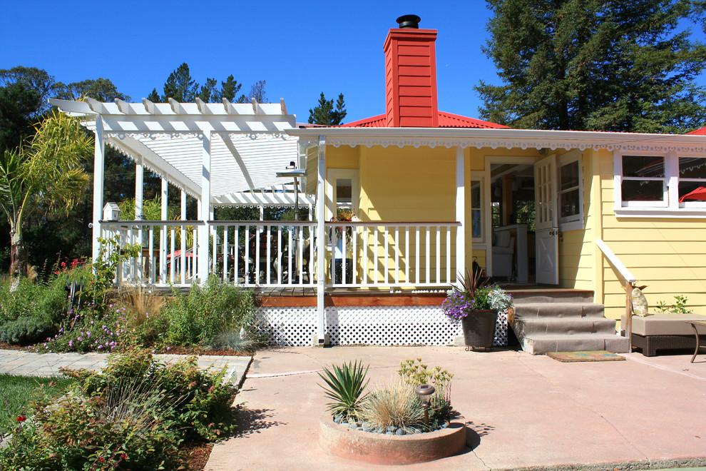 Traditional yellow exterior home idea in San Francisco