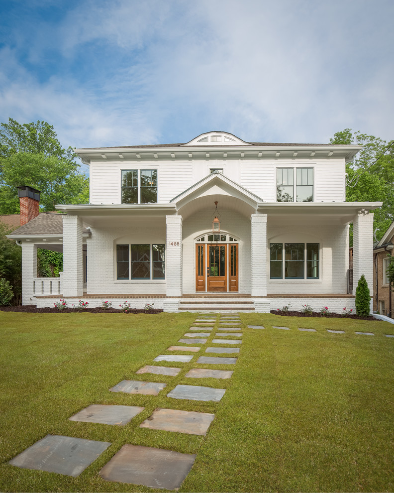 Transitional white two-story house exterior idea in Atlanta with a hip roof and a mixed material roof