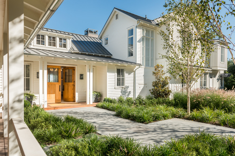Inspiration for a farmhouse white two-story gable roof remodel in San Francisco