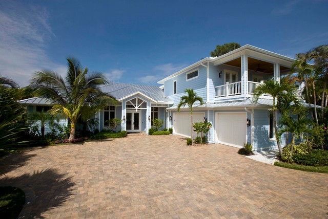 Island Style Blue Two Story Exterior Home Photo In Miami With A Hip Roof