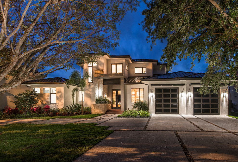 Large minimalist white two-story stucco gable roof photo in Miami