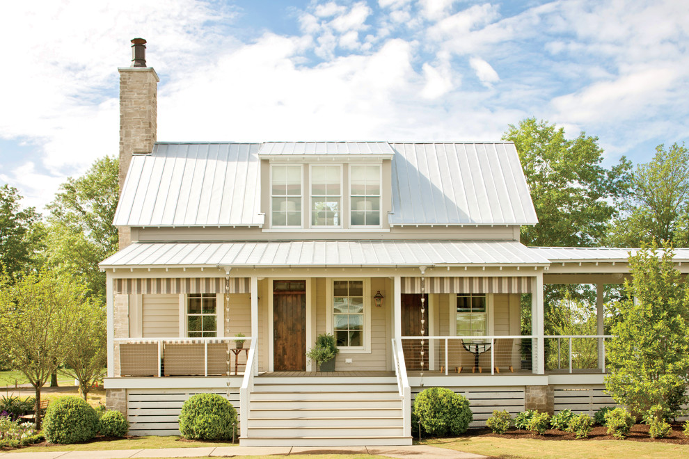 Inspiration for a large and beige country two floor exterior in Nashville with wood cladding and a hip roof.