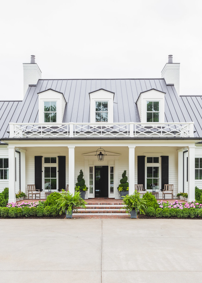 Example of a classic white two-story exterior home design in Nashville