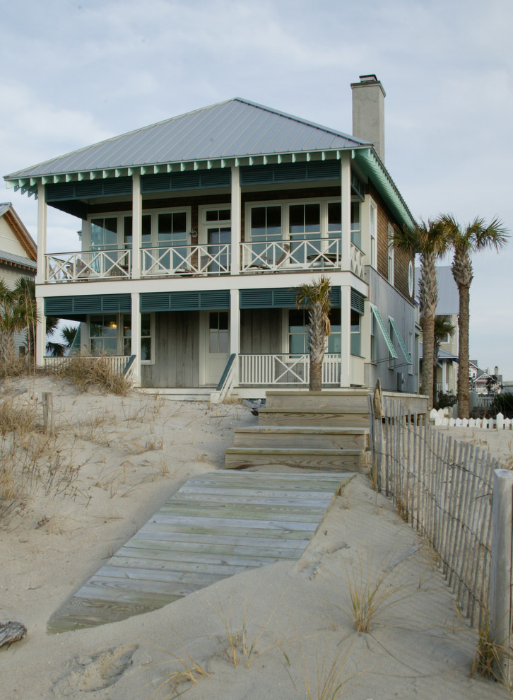 Mid-sized coastal two-story exterior home idea in Wilmington with a hip roof