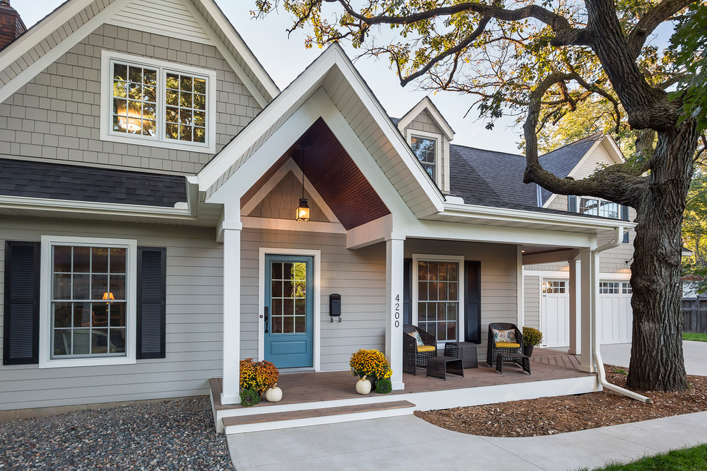 Mid-sized elegant gray two-story concrete fiberboard gable roof photo in Minneapolis