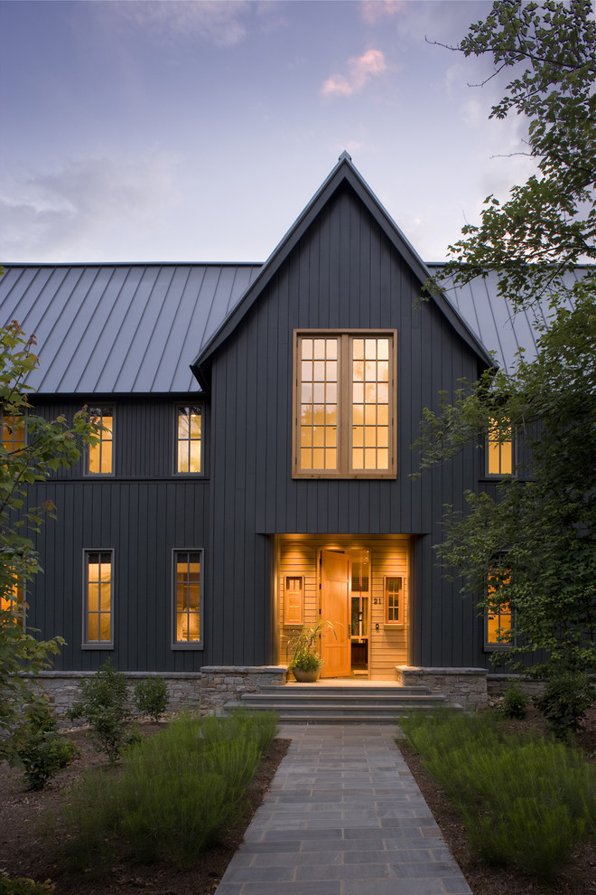 Transitional brown two-story wood house exterior photo in Charlotte with a metal roof