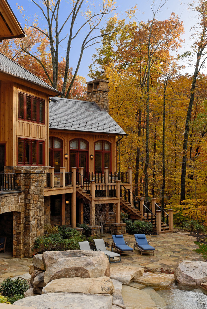 Huge rustic brown three-story mixed siding exterior home idea in DC Metro