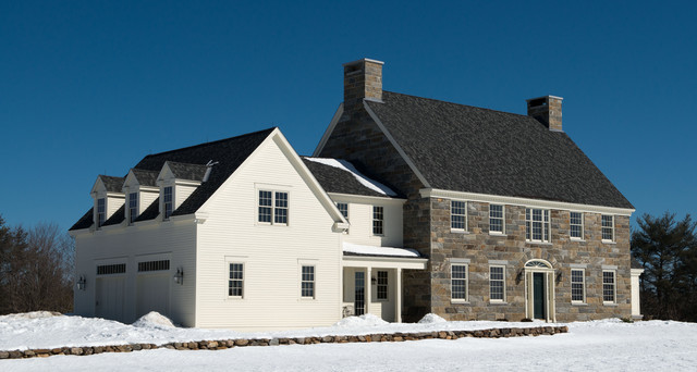 Inspiration for a large timeless two-story stone exterior home remodel in Boston