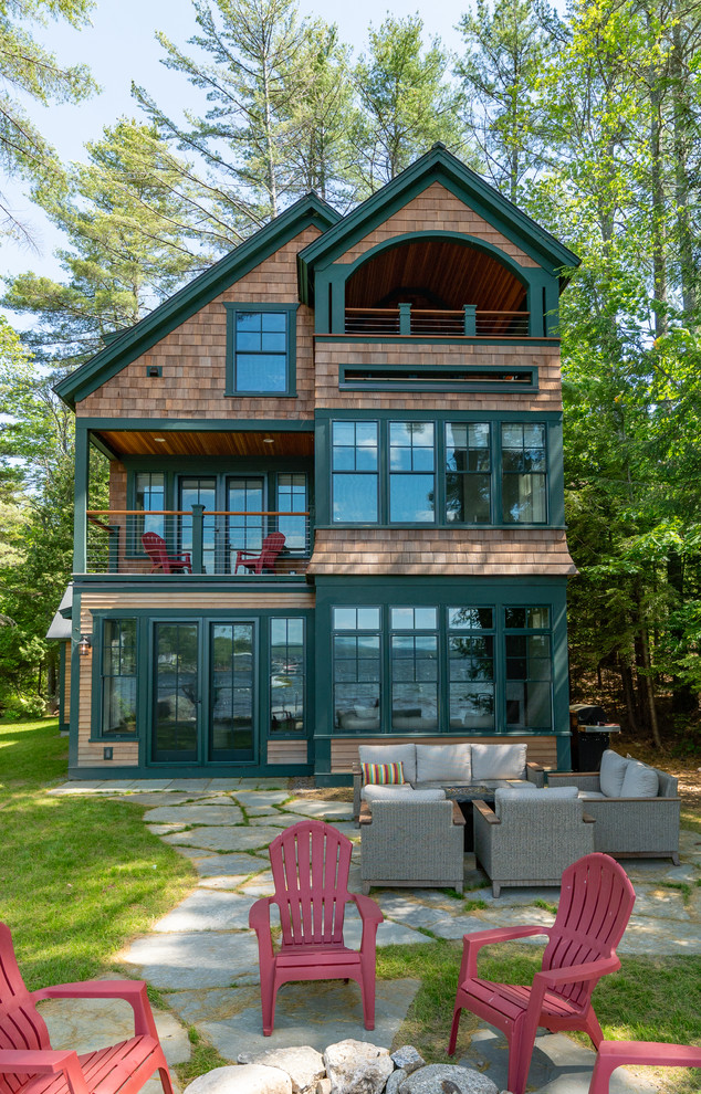 Inspiration for a large craftsman brown three-story wood exterior home remodel in Boston