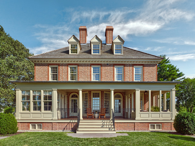 Traditional red two-story brick house exterior idea in Baltimore with a hip roof and a shingle roof
