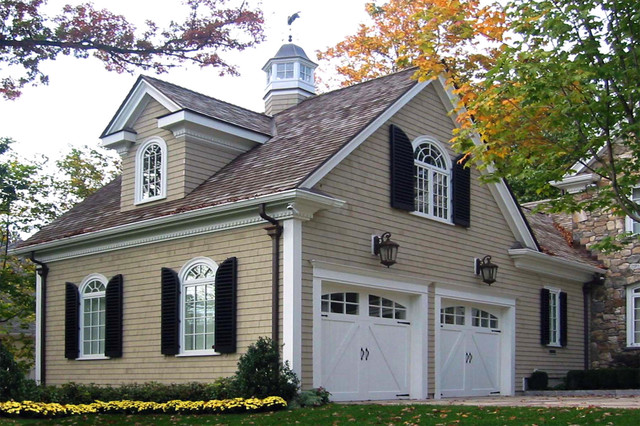 Inspiration for a large timeless beige two-story wood exterior home remodel in Boston with a shingle roof