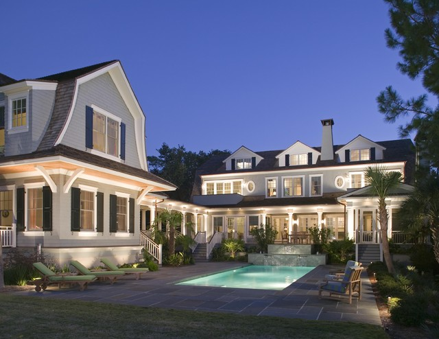 Night Lighting accentuates exterior of compound. traditional-exterior