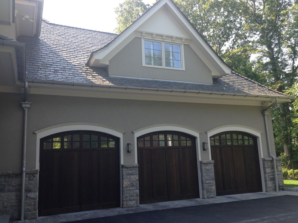 Example of a huge classic gray two-story stone exterior home design in New York