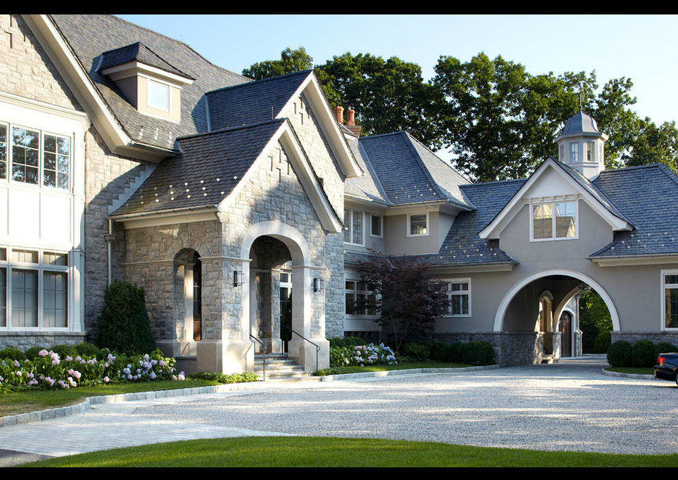 Inspiration for a huge timeless gray two-story stone exterior home remodel in New York