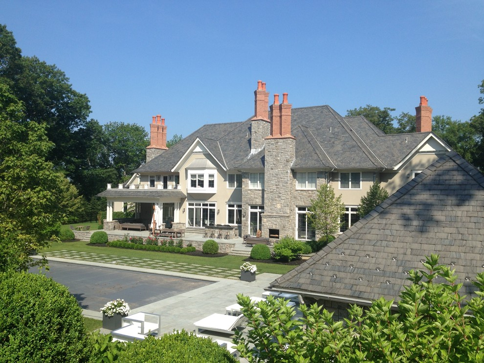 Inspiration for a huge timeless two-story stone exterior home remodel in New York