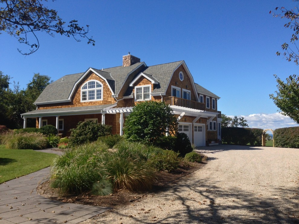 Example of a beach style two-story wood exterior home design in New York