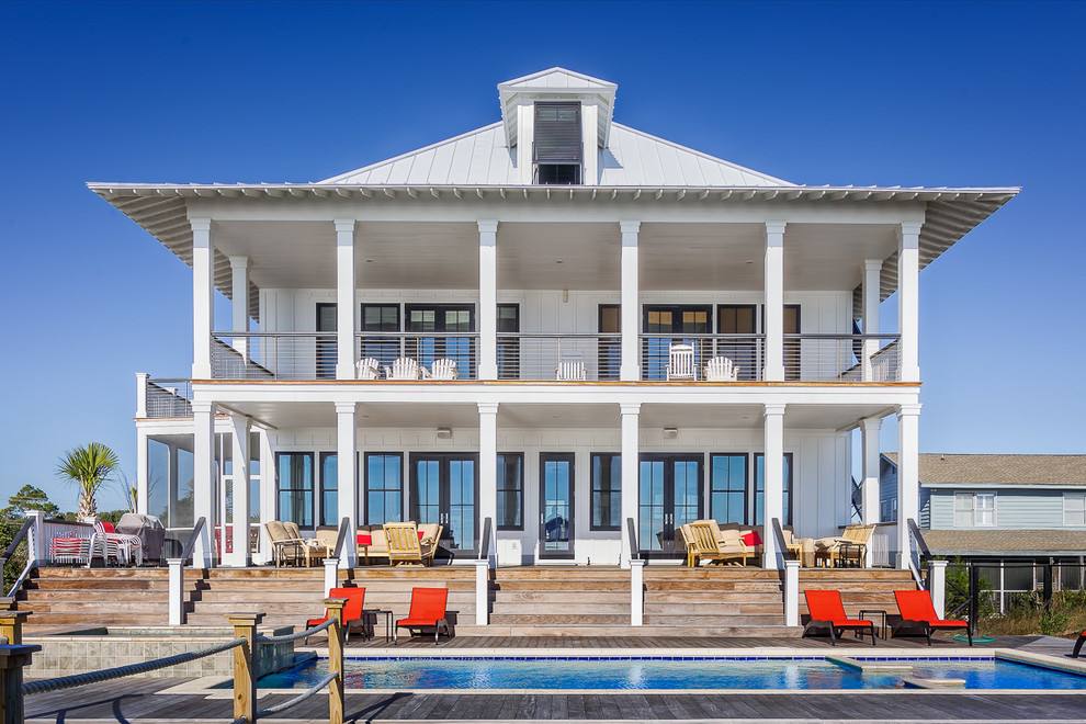 Coastal white two-story exterior home idea in Charleston with a hip roof