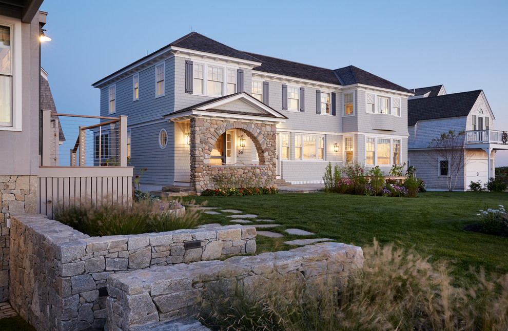 Inspiration for a coastal gray two-story wood house exterior remodel in Portland Maine with a hip roof and a shingle roof