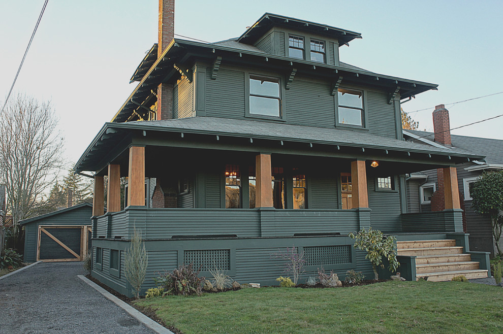 Inspiration for a transitional green wood exterior home remodel in Portland