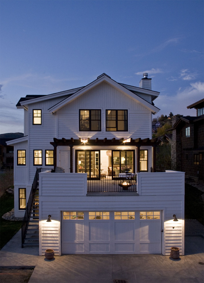 Mid-sized cottage two-story wood exterior home photo in Denver