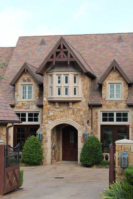 Example of a classic stone exterior home design in Dallas