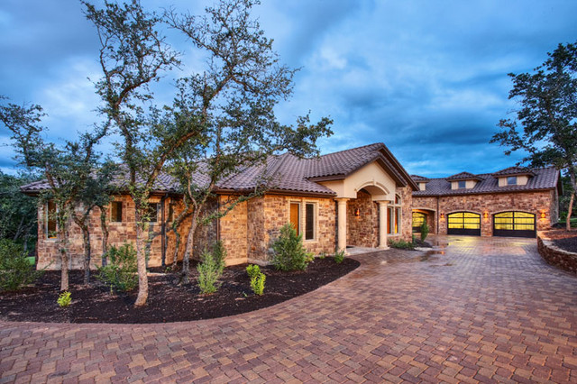 One story comfort mediterranean exterior austin by for Single story mediterranean style homes