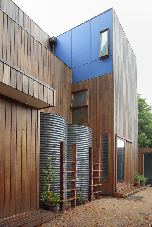 hide rainwater tanks behind ladders and trellis